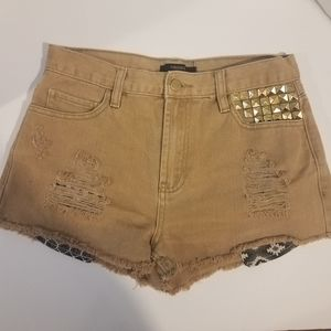 Tan shorts with distressed leg and studs